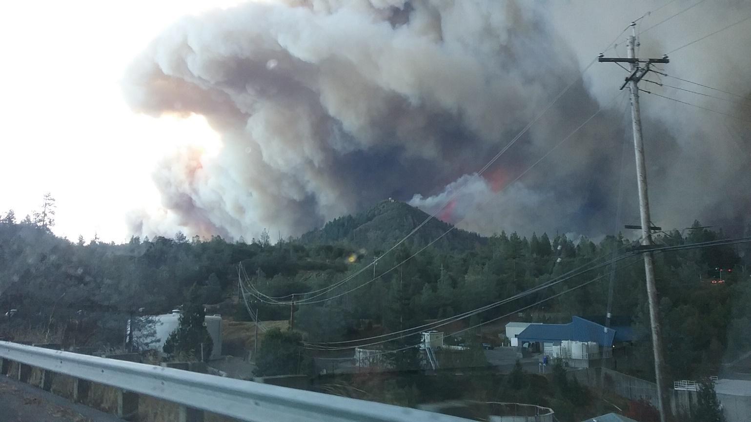 Mangan, smoke from sawmill peak